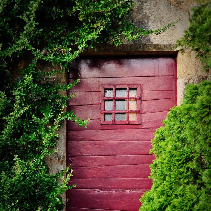Red door in alley way