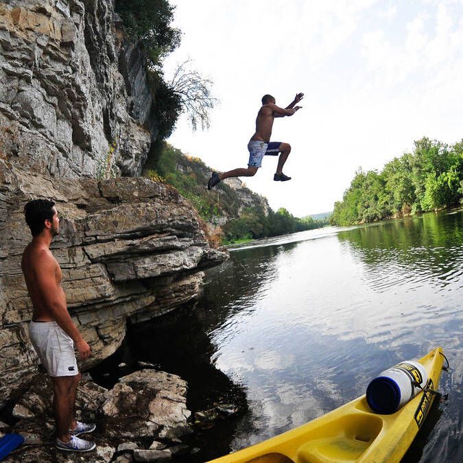 Jumping in the Dordogne river